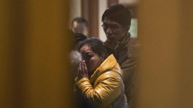 In shock ... A Chinese relative of passengers aboard a missing Malaysia Airlines plane looks out from a hotel room in ...