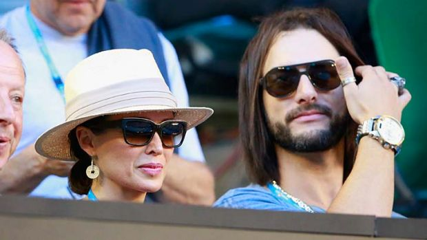 Singer Dannii Minogue and Adrian Newman look on in the men's final match between Rafael Nadal of Spain and Stanislas ...