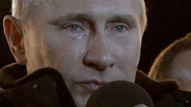 Putin reacts to a massive rally of his supporters at Manezh Square in Moscow.