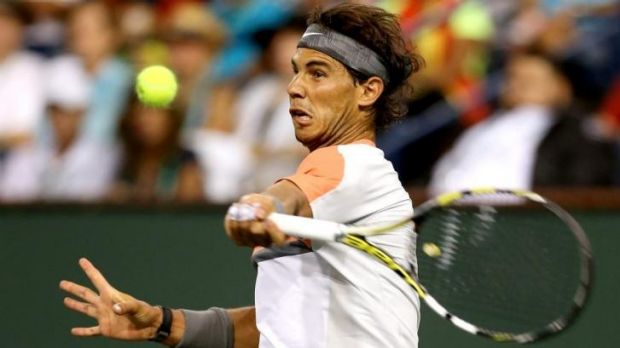 Upset: Rafael Nadal plays a forehand in his shock loss to Alexandr Dolgopolov at Indian Wells.