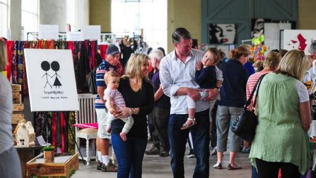 HOME HOLIDAY: VisitCanberra director Ian Hill enjoying a day at the Old Bus Depot Markets with his wife, Libby, and ...