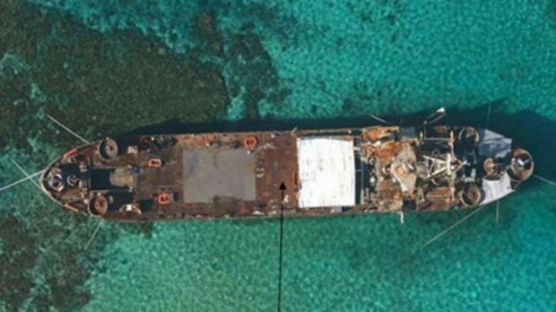 Grounded: BRP Sierra Madre, a 100-metre amphibious vessel part of the Filipino navy grounded at Second Thomas Shoal in ...
