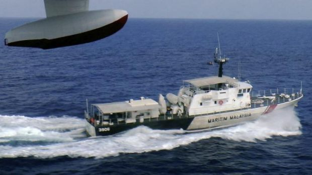 A patrol vessel of Malaysian Maritime Enforcement Agency searches for the missing Malaysia Airlines plane off Tok Bali ...