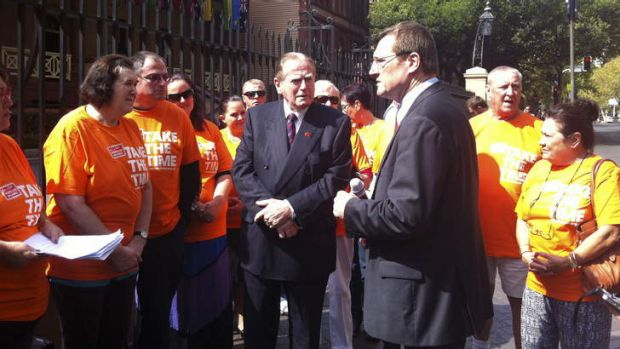 Christian Democratic Party MLC Fred Nile and Gerard Dwyer of the Shop Distributive and Allied Employees Association at a ...