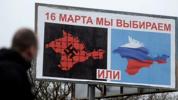 Strong message: Pro-Russia billboards show two visions of Crimea - one with a Russian flag, the other with a giant black ...