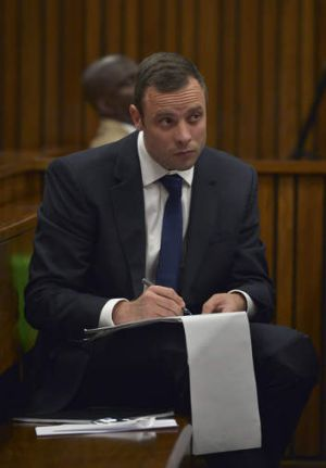Notes: Oscar Pistorius in court during his trial on Wednesday.