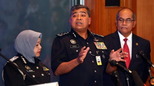 Tan Sri Khalid Ibrahim, Inspector General Police of Malaysia (centre) briefs the media on the progress of their ...