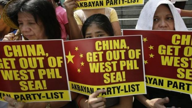 Protesters picket the Chinese consulate in Manila to protest the use of water cannon by the Chinese coast guard to drive ...