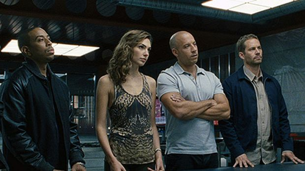 <i>Fast & Furious 7</i> resumes filming with Vin Diesel and Ludachris (pictured) after Paul Walker (far right)  died in ...