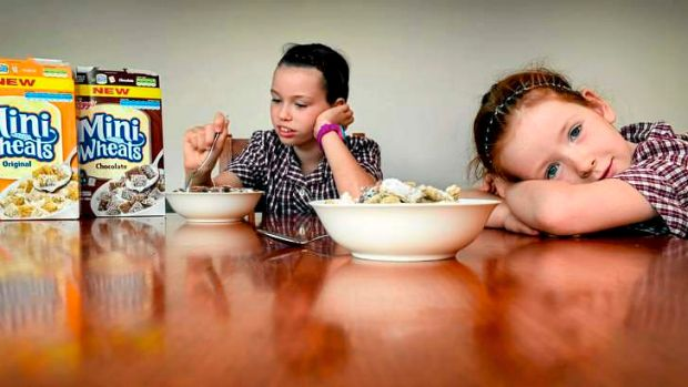 Madison and Emily Adams with the new sugar-laden version of Kellogg's Mini-Wheats.