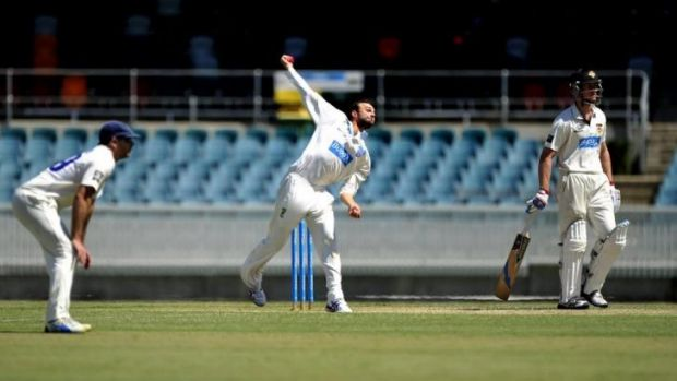 NSW bowler Nathan Lyon in action on Wednesay at Manuka Oval.