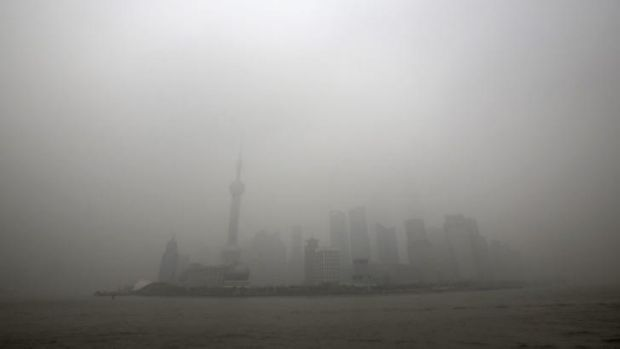 What they have to work with: The skyline of the Lujiazui Financial District is covered with heavy smog in Pudong, Shanghai.