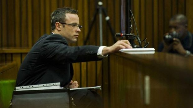 Sickened: Oscar Pistorius, wearing glasses to write notes, in the dock on Thursday.