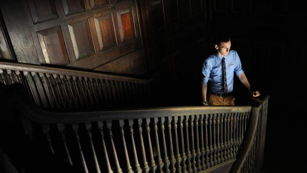 Faded glory ... heritage consultant Rupert Mann on the teak staircase of the derelict colonial era Pegu club.