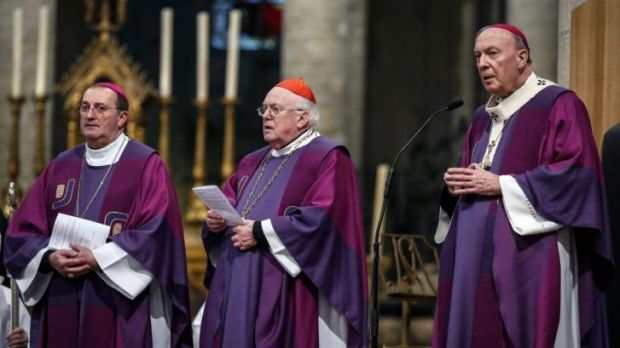 """Archbishop Andre-Joseph Leonard (R) and Cardinal Godfried Danneels (C) attend a mass in celebration of """"One Year Pope ..."""