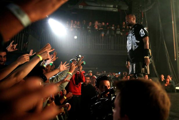 Before the crash ... Kanye West performs onstage with JAY Z at SXSW on March 12, 2014.