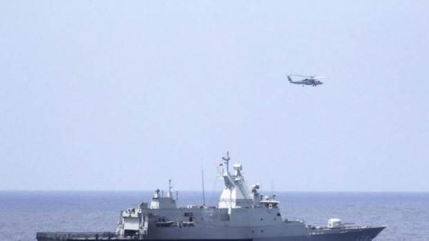 The Royal Malaysian Navy corvette KD Terengganu and a US Navy MH-60R Sea Hawk helicopter from the US Navy guided-missile ...