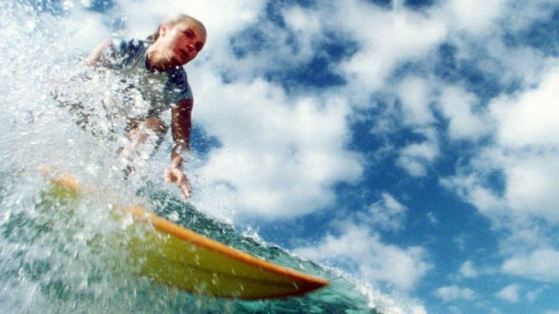 Actress Kate Bosworth rides a wave in a scene from <i>Blue Crush</i>.
