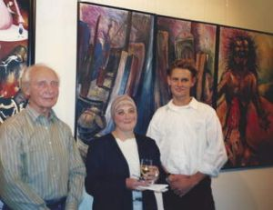 The 17-year-old artist at Artexpress with Reinis Zusters and Margaret Woodward.