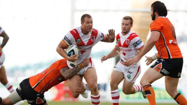 Dragons prop Trent Merrin on the charge against the Wests Tigers last weekend.