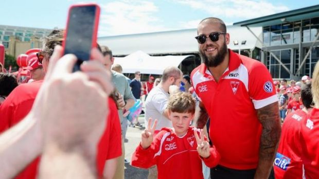 Crowd pleaser: Lance Franklin poses for a photo with a young Swans supporter.
