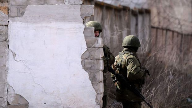 Keeping guard: Russian troops outside a military base in Ukraine.