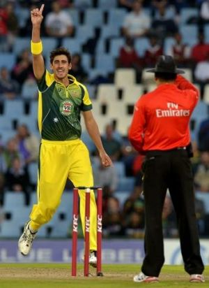 Breakthrough: Mitchell Starc successfully appeals for the wicket of dangerous South African batsman Hashim Amla.