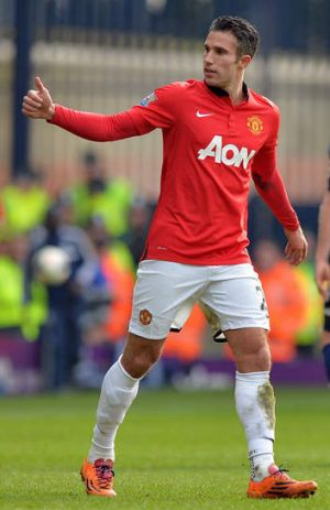 Thumbs up: Robin van Persie says he is happy at Manchester United.