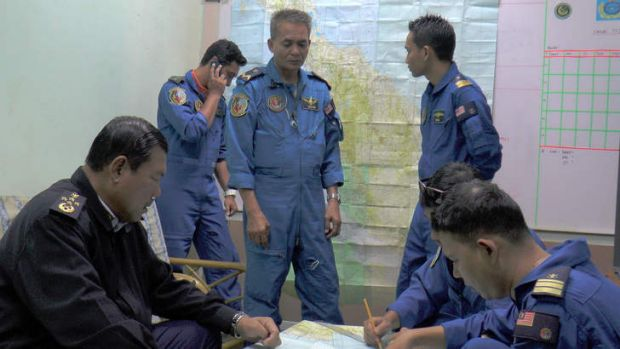 Malaysia's Maritime Enforcement personnel during search and rescue operations of missing flight MH370.