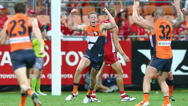 Sam Frost of the Giants celebrates kicking a goal.