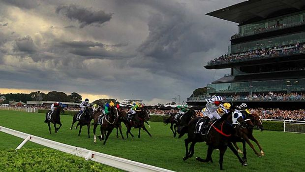 Guineas coup: Jim Cassidy sees off his fellow New Zealanders to ride Dissident to victory.