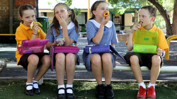Choice is healthy: Abbie O'Toole, Eliza and Zoe Box and Austin O'Toole eat their lunches in Sydney this week.
