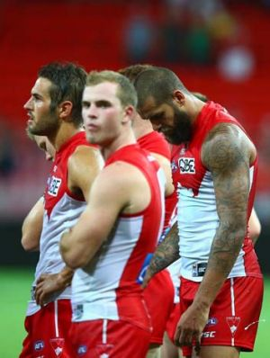 Lance Franklin and team mates look dejected after their round one match.
