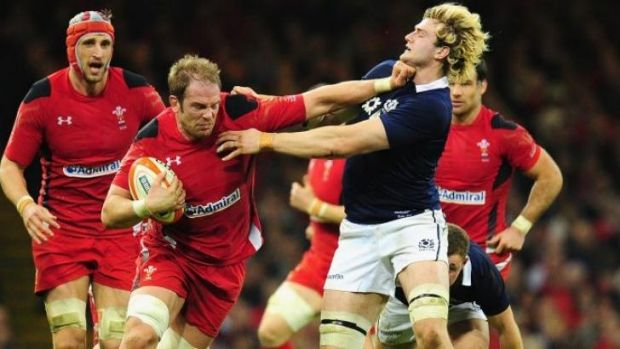 At arm's length: Alun Wyn Jones of Wales palms of Richie Gray of Scotland.