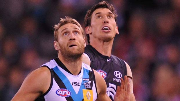 Port Adelaide's Jay Schulz and Carlton's Michael Jamison.
