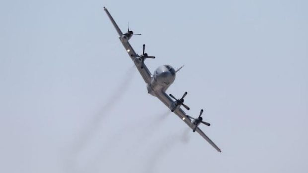 A RAAF Orion aircraft in flight during an air show.