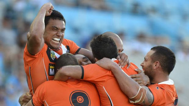 Wests Tigers' Martin Taupau celebrates with team mates after his try against the Titans.