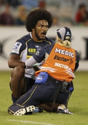 Brumbies winger Henry Speight receives attention after hurting his jaw during the victory over the Waratahs.