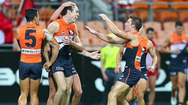 Jeremy Cameron of the Giants celebrates after kicking a goal.