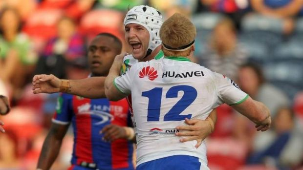 Triumph: Jarrod Croker of the Raiders celebrates a try with teammate and former Knights player Joel Edwards, no.12.