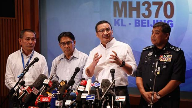 Hijacking a possibility: Malaysia's acting Transport Minister, Hishammuddin Hussein, second from right, speaks at a news ...