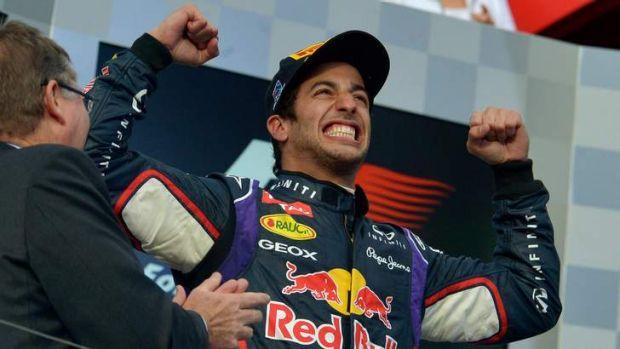Australian Daniel Ricciardo celebrates his second place before the controversial disqualification.