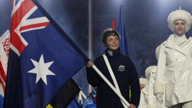 Fourteen-year-old Ben Tudhope carries Australia's flag at the closing ceremony.