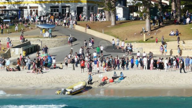 Crowds gather for mermaid protest