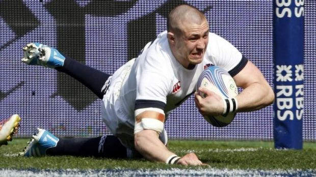 Try-scoring spree: England's Mike Brown crosses the line against Italy.