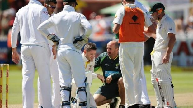Michael Clarke receives treatment after withstanding a pace barrage from South African fast bowler Morne Morkel. Scans ...