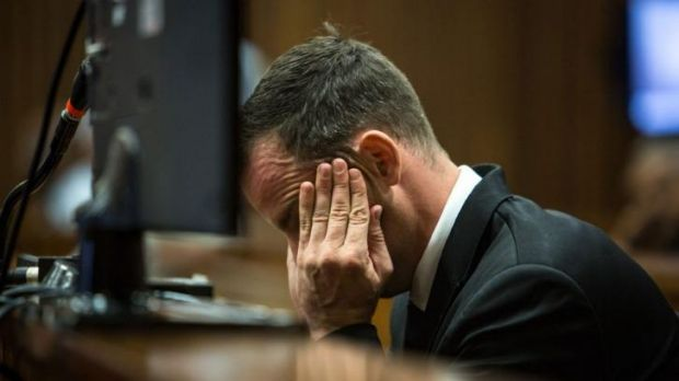 South African Paralympic athlete Oscar Pistorius sits in the dock on day eleven of his trial for the murder of his ...