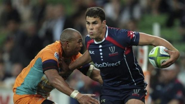 """I owe Rebels the world"": Tom English breaks a tackle against the Cheetahs."