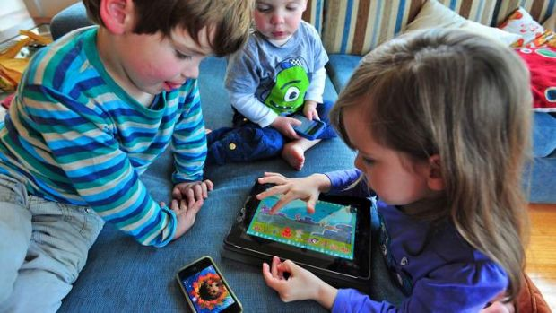 Milli age 5, Robbie age 3 and Nicolas age 2 with their electronic devices.