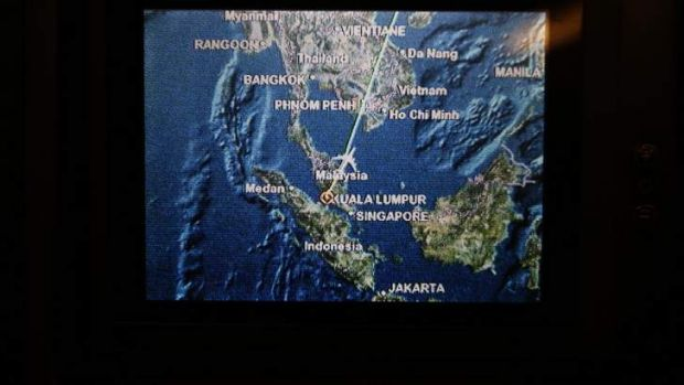 A screen on board Malaysia Airlines Boeing 777-200ER flight MH318 shows the plane's flight path as it cruises over the ...